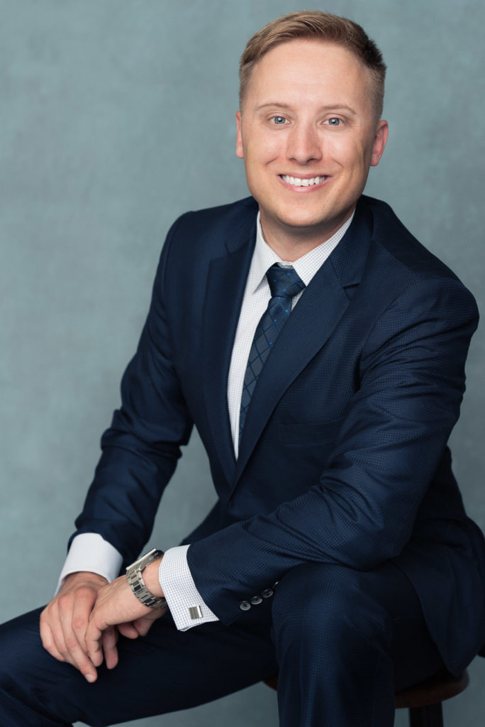 professional and modern headshot for men in blue suit